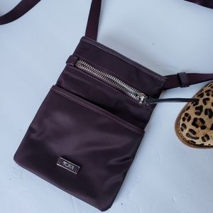 TUMI plum purple crossbody small phone wallet bag